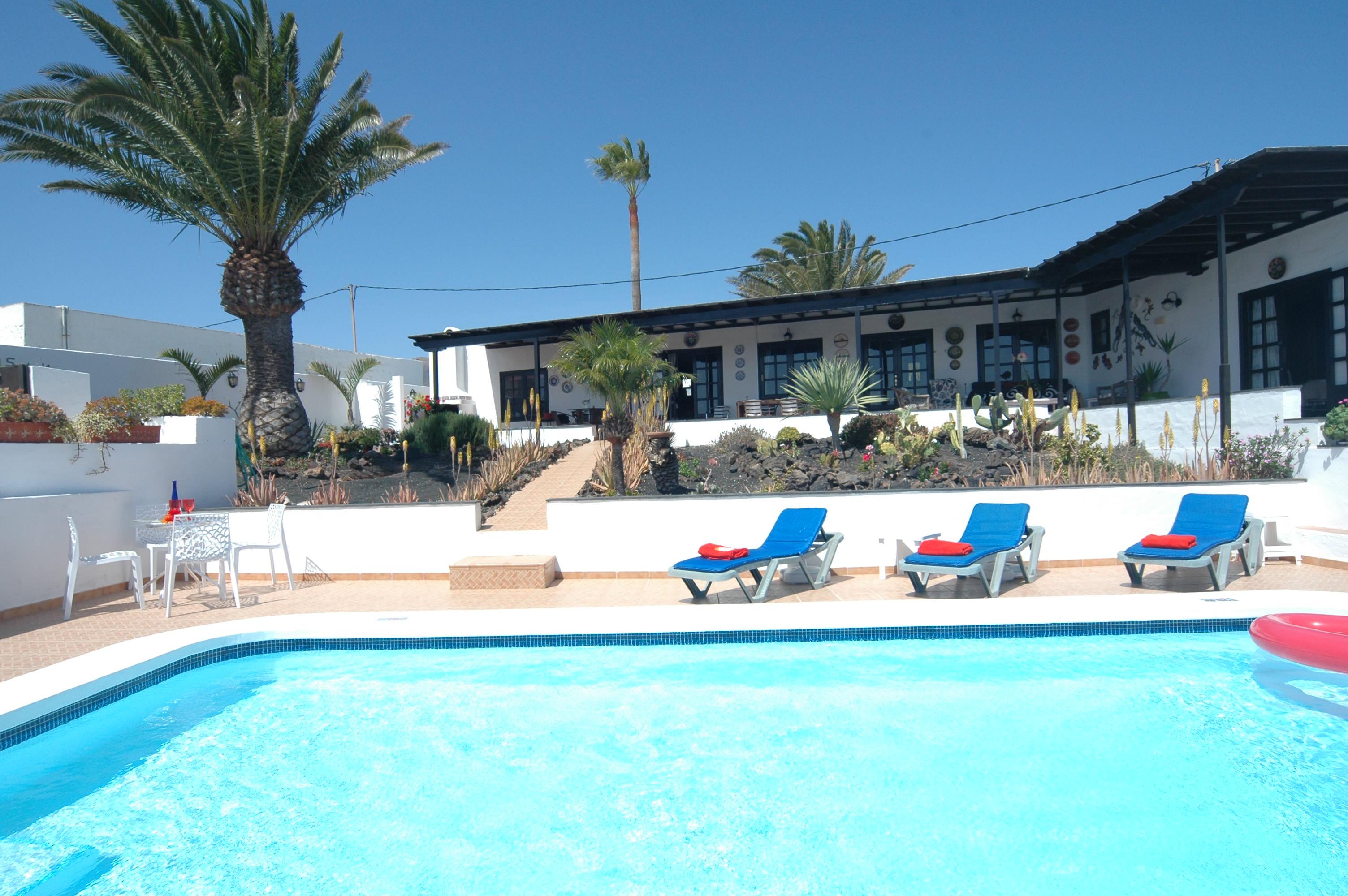 LVC198622 sunbathing by the pool