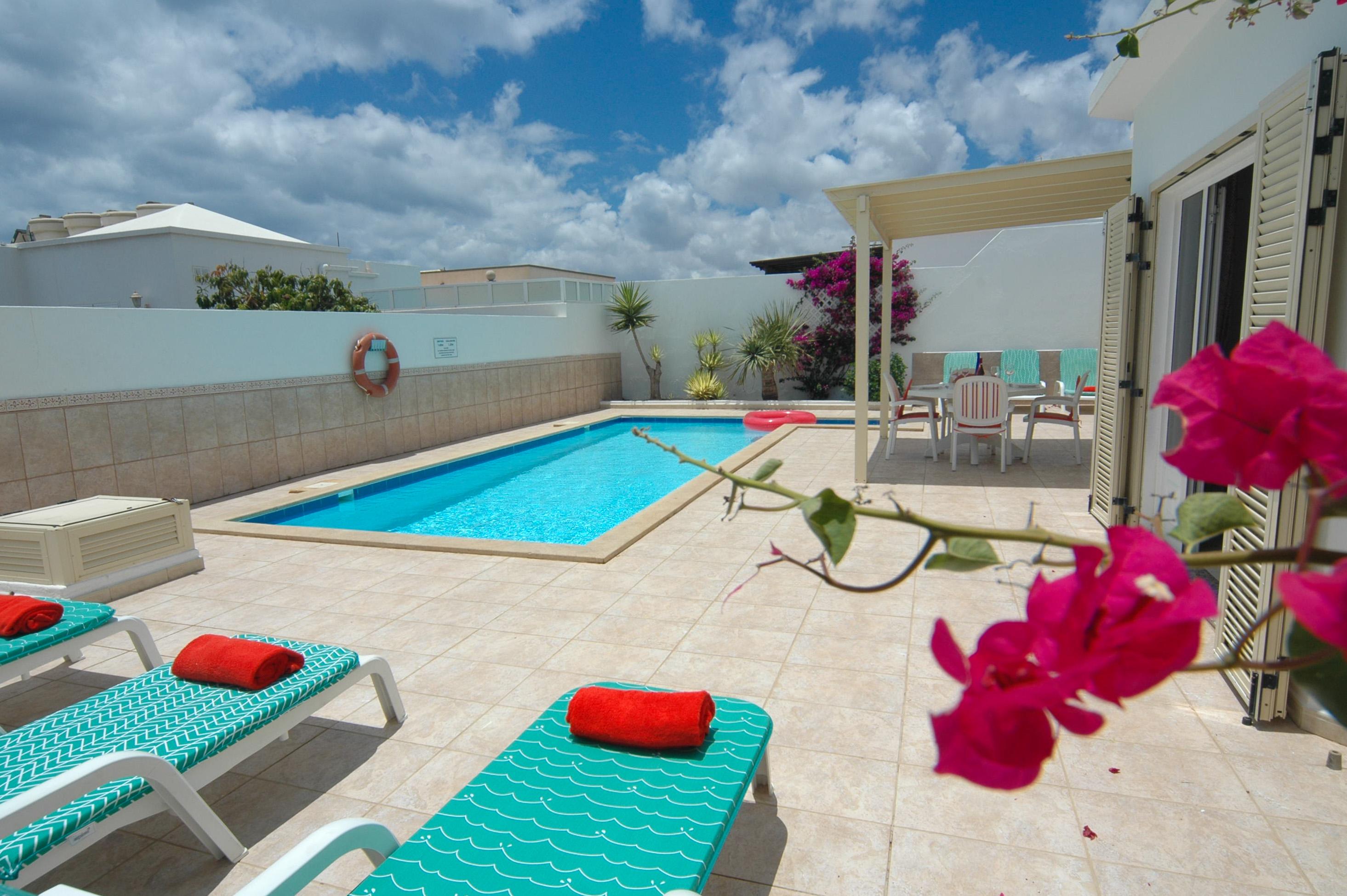LVC212405 Sunbathing by the pool