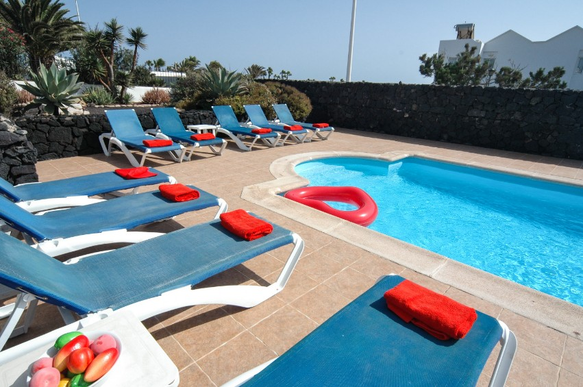 LVC200823 sunbathing by the pool