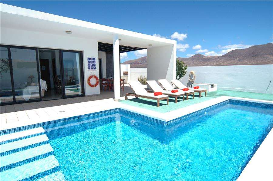 Relax round the pool on your Lanzarote holiday