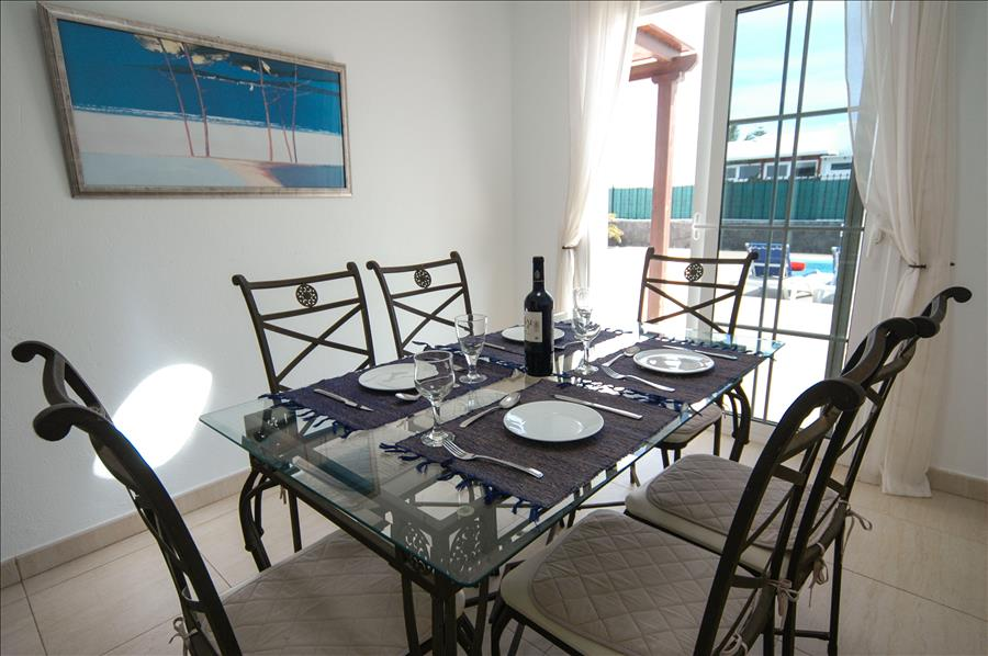 Villa LVC227774 Dining area with patio doors to terrace