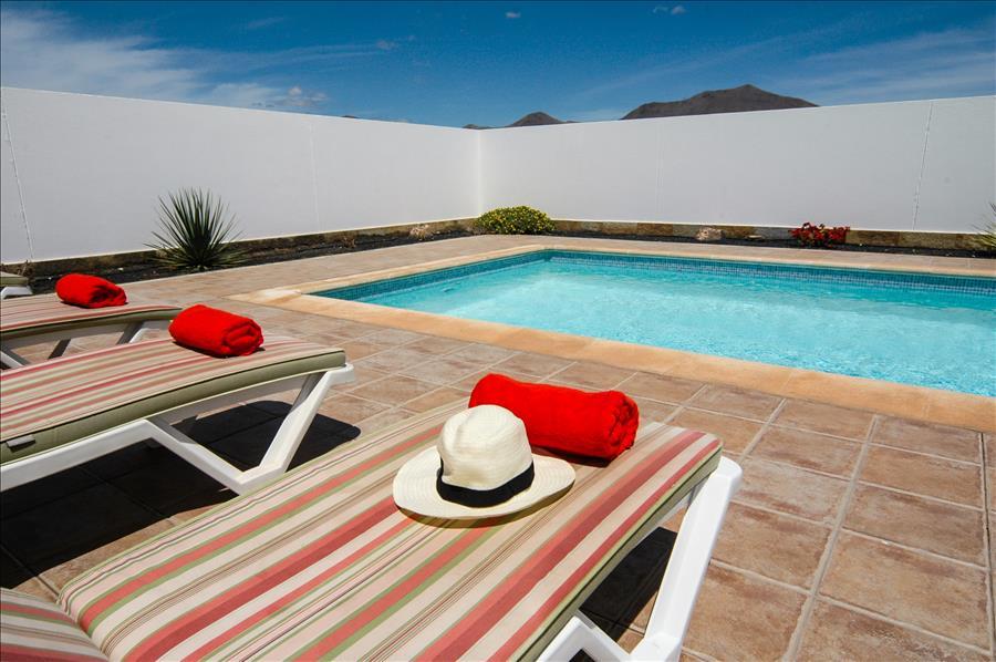 LVC228143 Sunbathing by the pool
