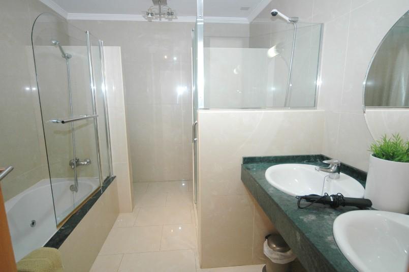LVC261708 Bathroom with bath and overhead shower