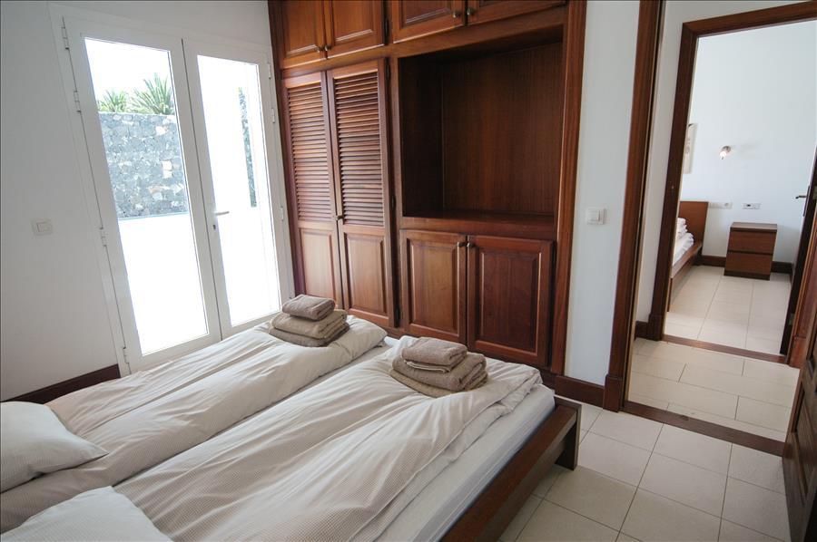 LVC268839 Bedroom with patio doors to balcony