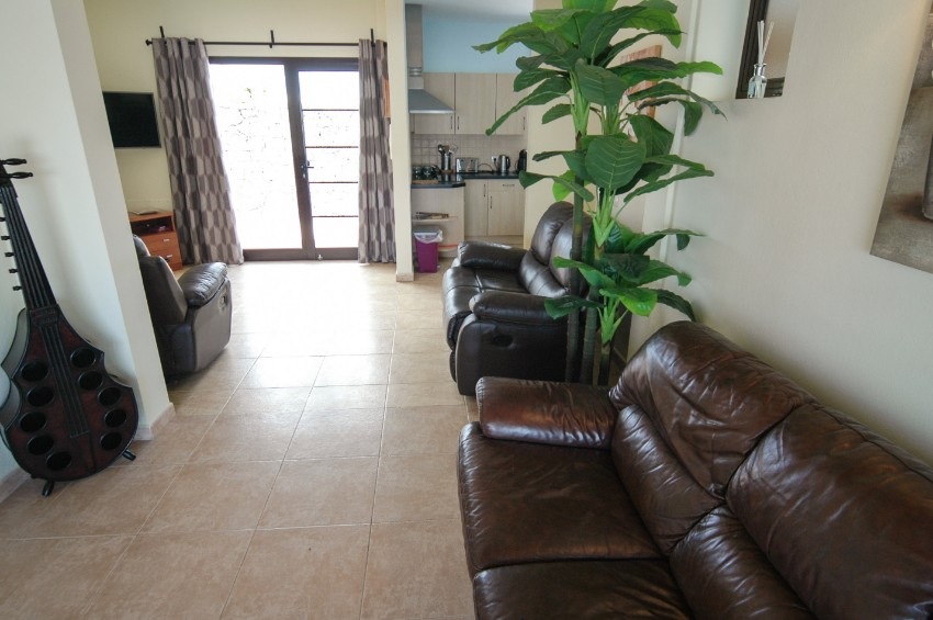 Villa LVC269311 The living area is compact but furnished with comfortable sofas