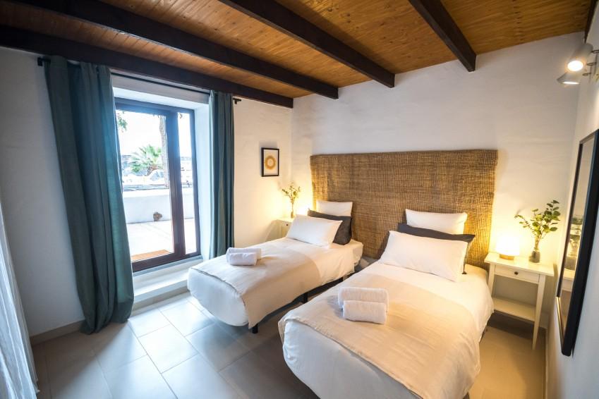 Villa LVC275611 Twin bedroom with doors to terrace