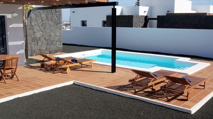 LVC292215 Sunbathing by the pool