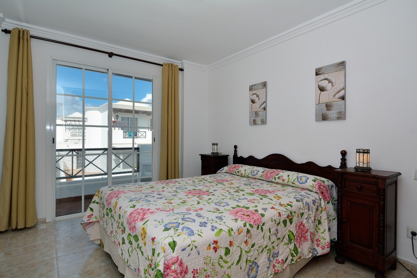 Double bedroom with doors to balcony with views